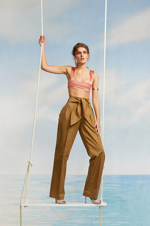 Cynthia Rowley Spring 2018 Look 15 featuring a pink silk bar top and dark khaki pants