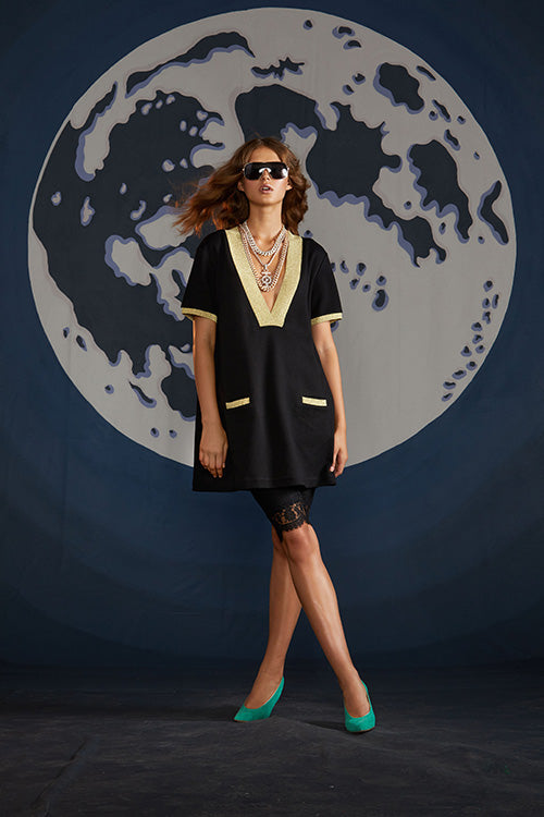 Cynthia Rowley Spring 2019 look 15 featuring a black mini dress with gold details, short sleeves and a deep V-neck
