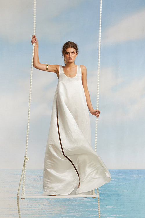 Cynthia Rowley Spring 2018 Look 16 featuring a sleeveless white silk wool maxi dress with grosgrain ribbon