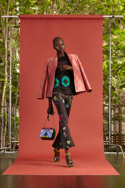 Cynthia Rowley Resort 2017 look 17 featuring a pink blazer, black and blue shirt, and colorful printed flares