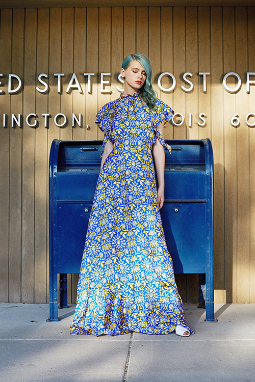 Cynthia Rowley 2019 Resort Collection features a high-collared royal blue and yellow floral printed maxi dress.
