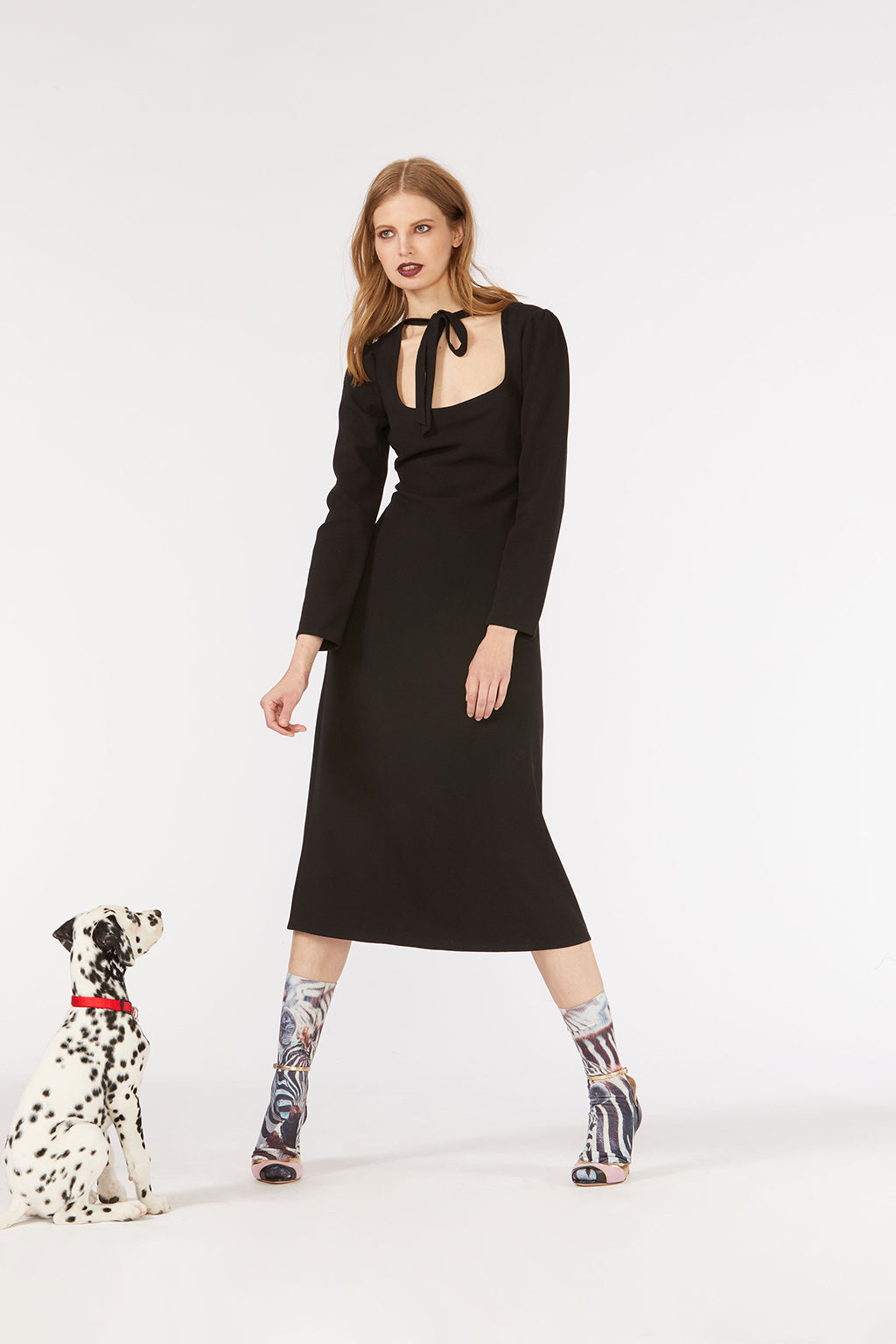 Cynthia Rowley Fall 2018 look 19 featuring a black scoop neck long sleeve midi dress with neck tie detail.