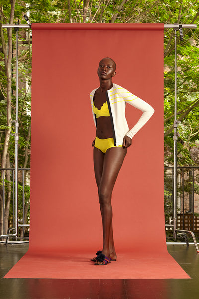 Cynthia Rowley Resort 2017 look 21 featuring a yellow bikini with a light yellow sweater