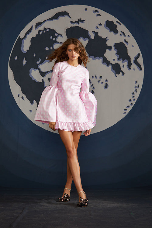 Cynthia Rowley Spring 2019 look 22 featuring a mini dress with long oversized bell sleeves and ruffled details in a pink and white print