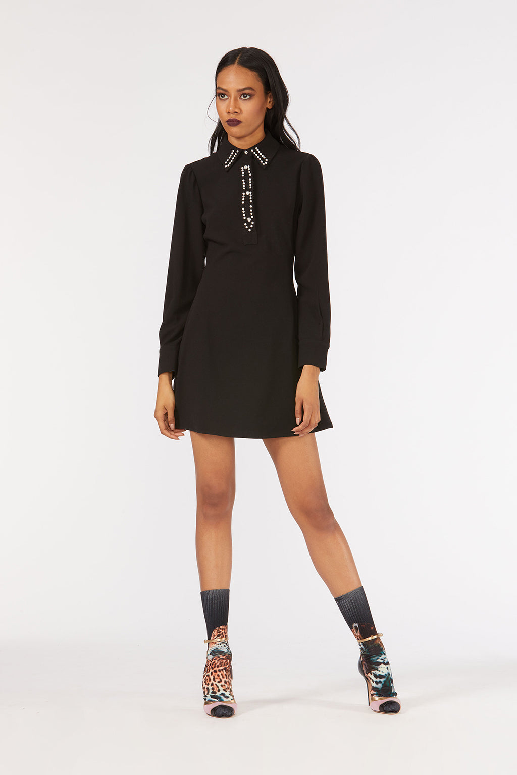 Cynthia Rowley Fall 2018 look 26 featuring a black long sleeve shirt dress with rhinestone embellishments.