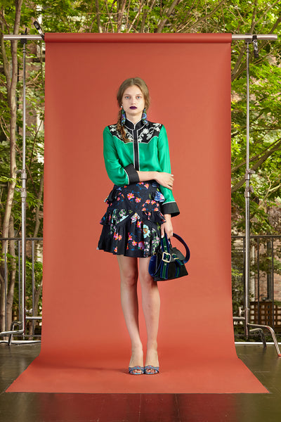 Cynthia Rowley Resort 2017 look 27 featuring a green blouse with a black floral ruffle mini skirt