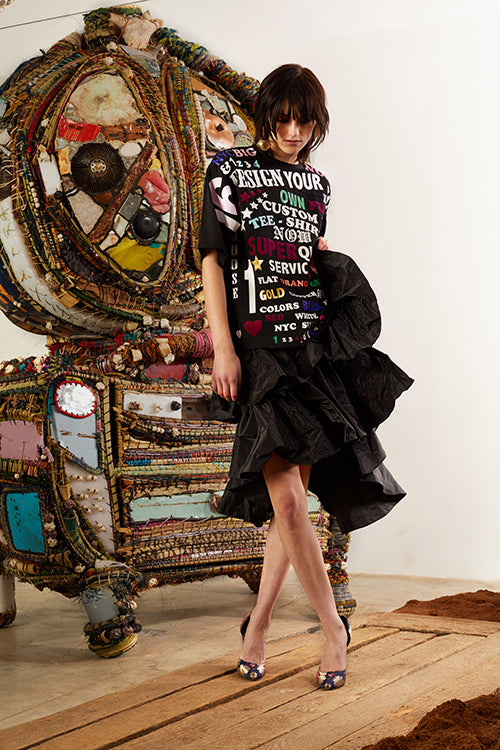Cynthia Rowley Pre-Fall 2018 Look 2 featuring a t-shirt with graphic text and a black silk taffeta ruffle skirt
