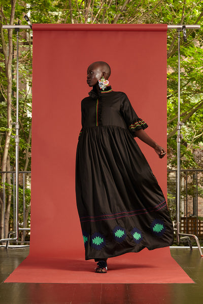 Cynthia Rowley Resort 2017 look 30 featuring a black maxi dress with a turquoise print on the bottom