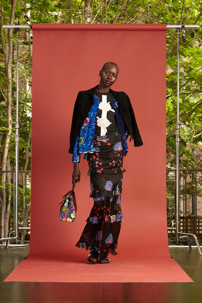 Cynthia Rowley Resort 2017 look 32 featuring a black floral cotton t shirt, black jacket, and black floral tiered maxi skirt
