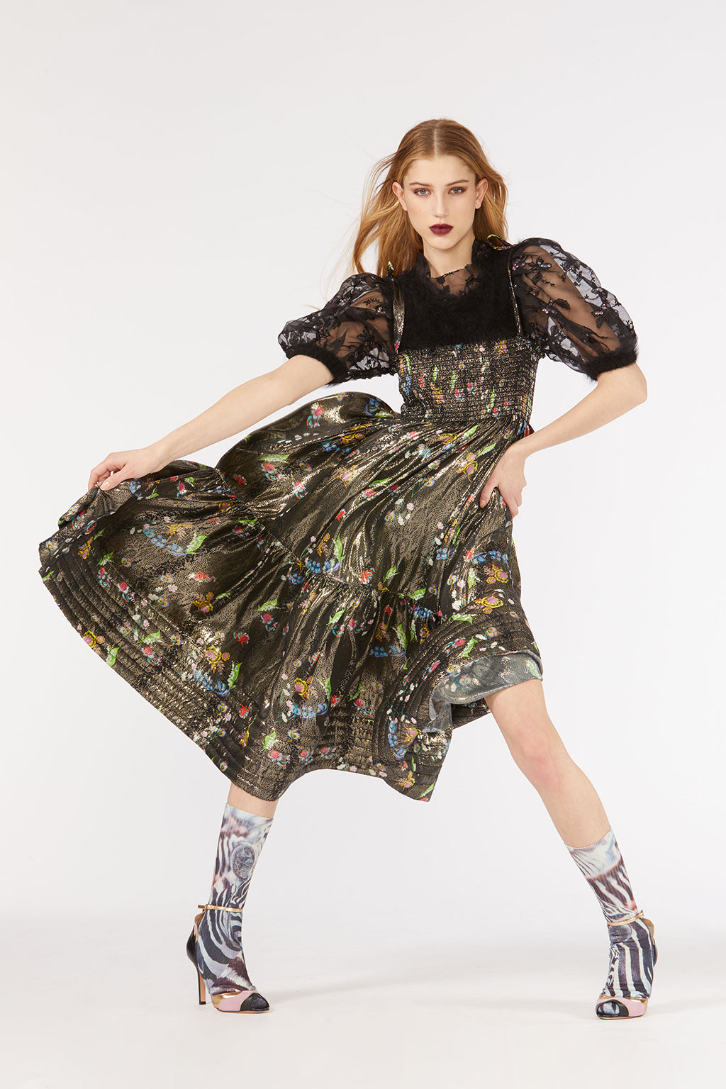 Cynthia Rowley Fall 2018 look 34 featuring a metallic floral tiered dress with smocking across chest and black embroidered tulle puff sleeves.
