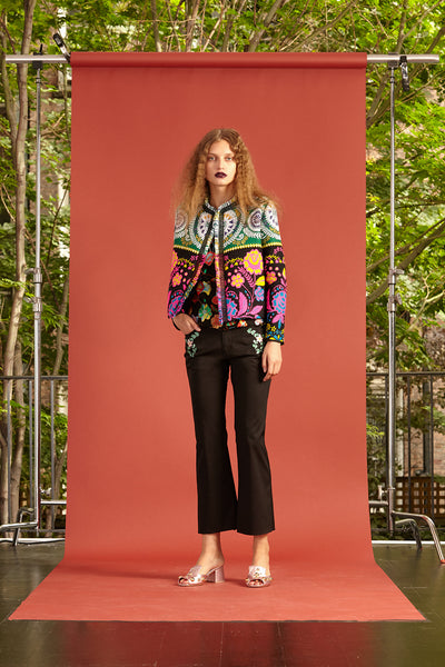 Cynthia Rowley Resort 2017 Look 3 featuring a vibrant jacket and black pants