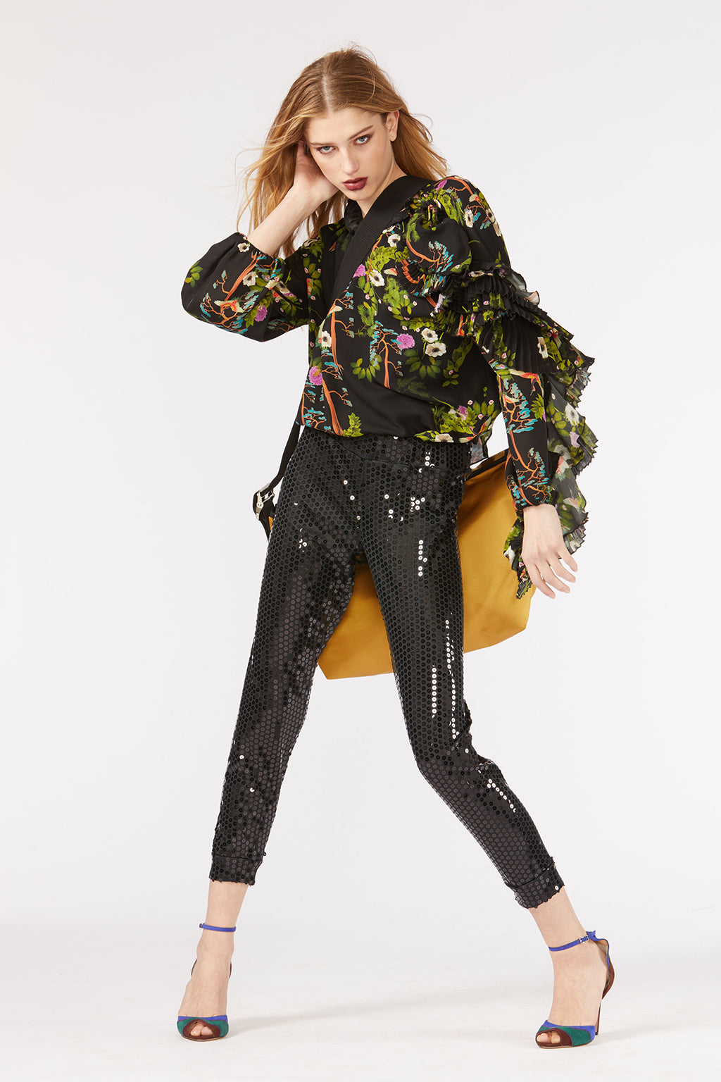 Cynthia Rowley Fall 2018 look 4 featuring sequin leggings and printed blouse with ruffled sleeve.