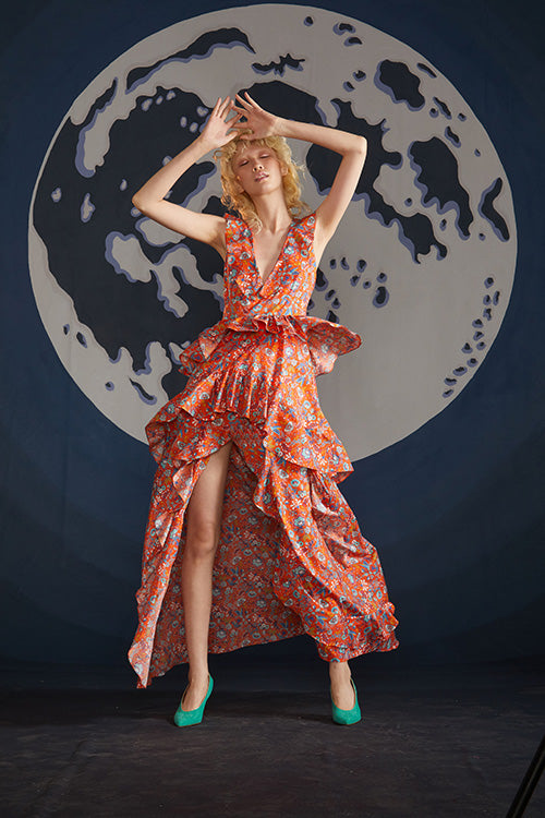 Cynthia Rowley Spring 2019 look 5 featuring a maxi dress with deep V-neck, ruffled details and an open front in orange floral print
