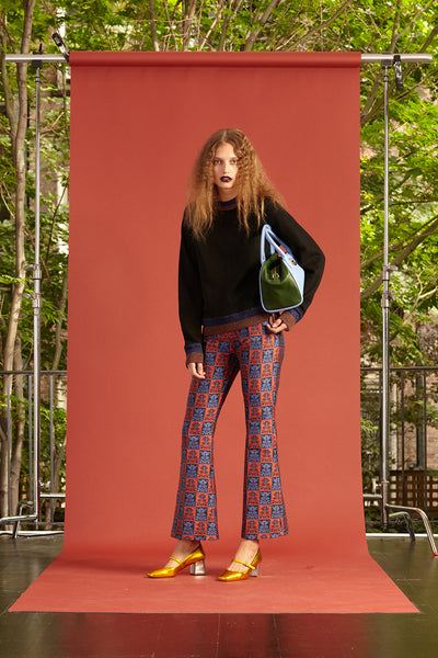 Cynthia Rowley Resort 2017 look 8 featuring a navy sweatshirt and red and blue brocade pants