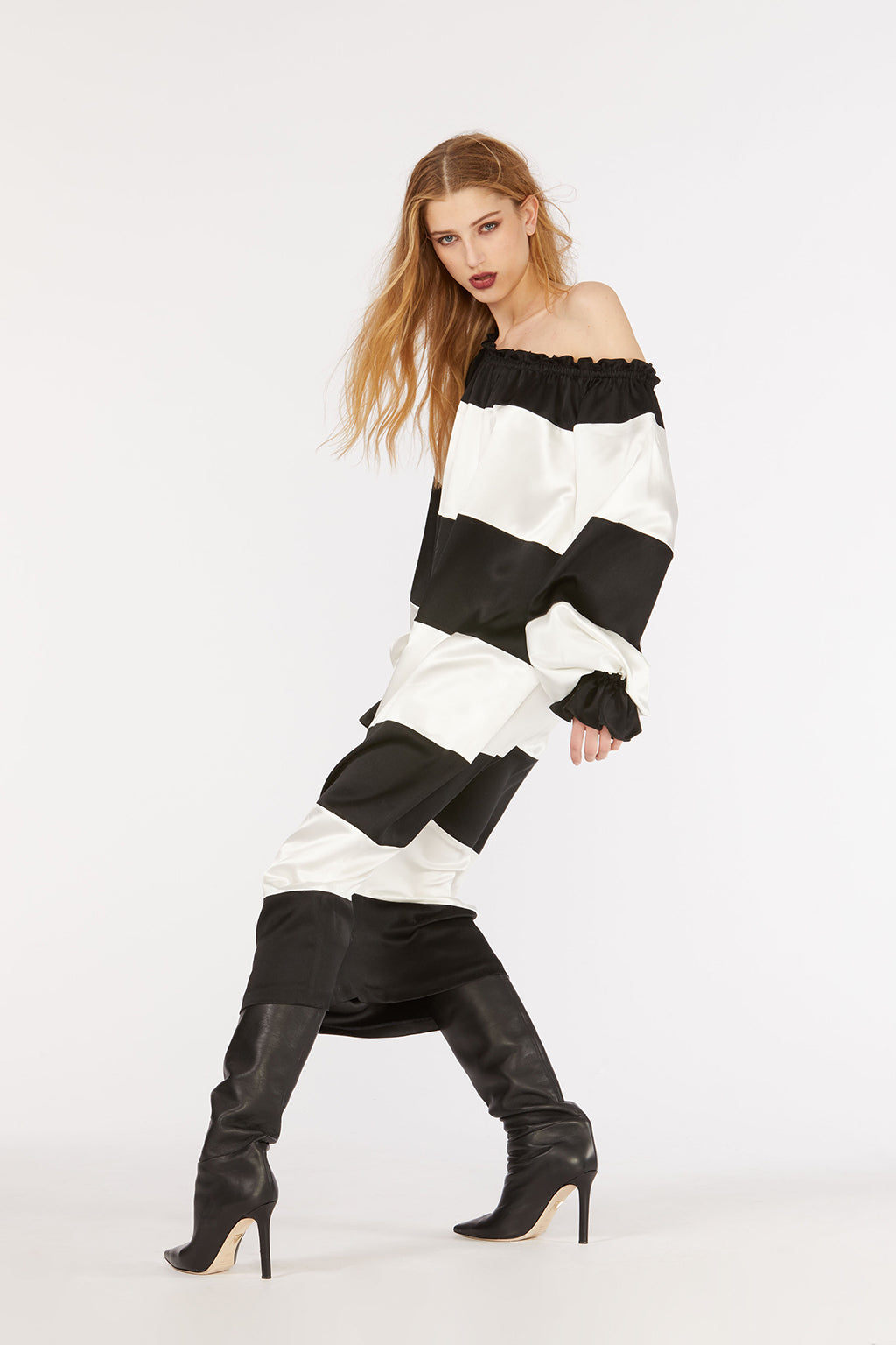 Cynthia Rowley Fall 2018 look 9 featuring a black and white stripe off-shoulder dress.