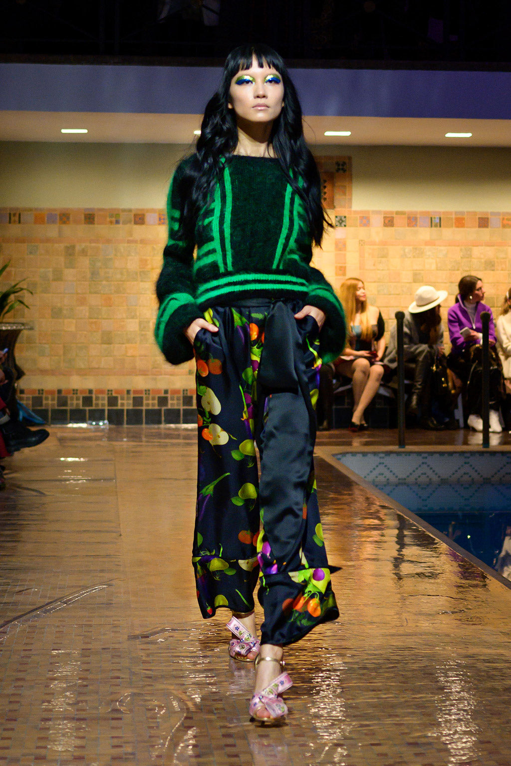 Cynthia Rowley Fall 2019 look 10 featuring a black and green abstract print sweater with long sleeves worn over a fruit printed flare pant