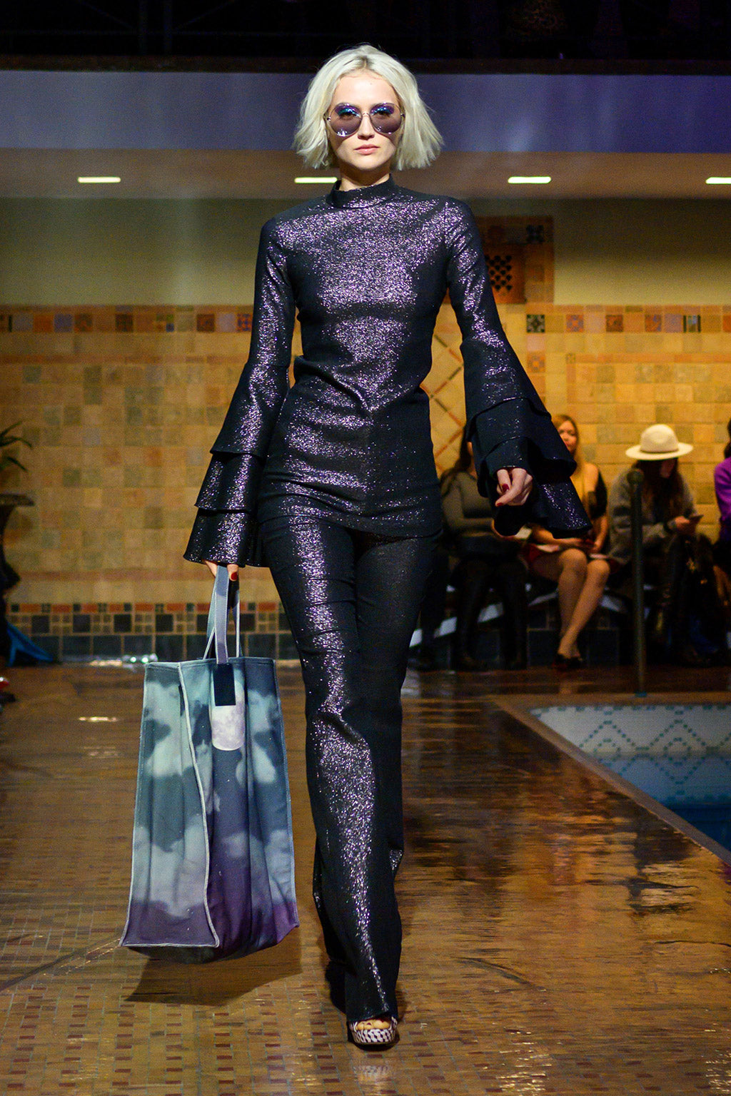 Cynthia Rowley Fall 2019 look 13 featuring a dark purple metallic top with long bell sleeves and a flare pant in the same print