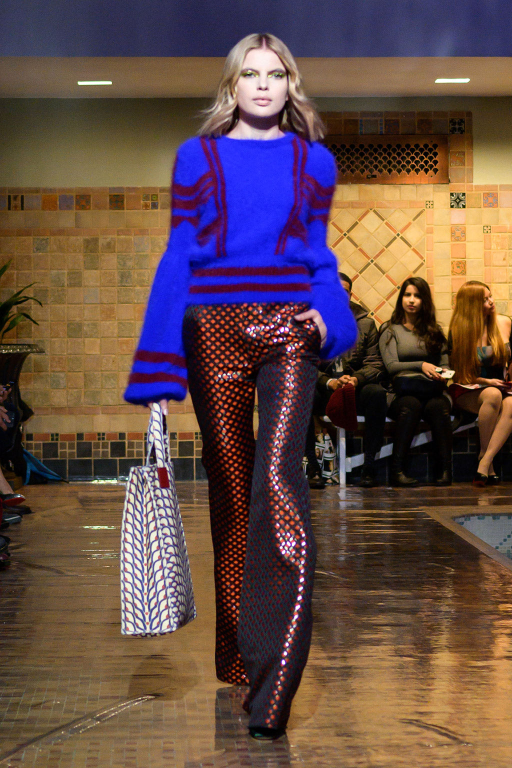 Cynthia Rowley Fall 2019 look 14 featuring a sweater with abstract print and pants with orange and black fish scale print