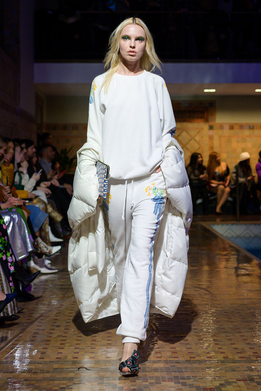 Cynthia Rowley Fall 2019 look 24 featuring a white sweater with floral applications and matching sweatpants with stripes on both sides