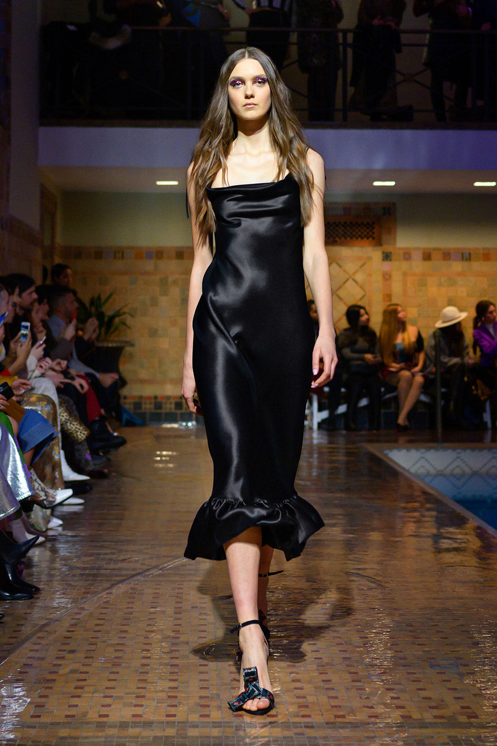 Cynthia Rowley Fall 2019 look 6 featuring a black satin slip dress with ruffle finish at the bottom
