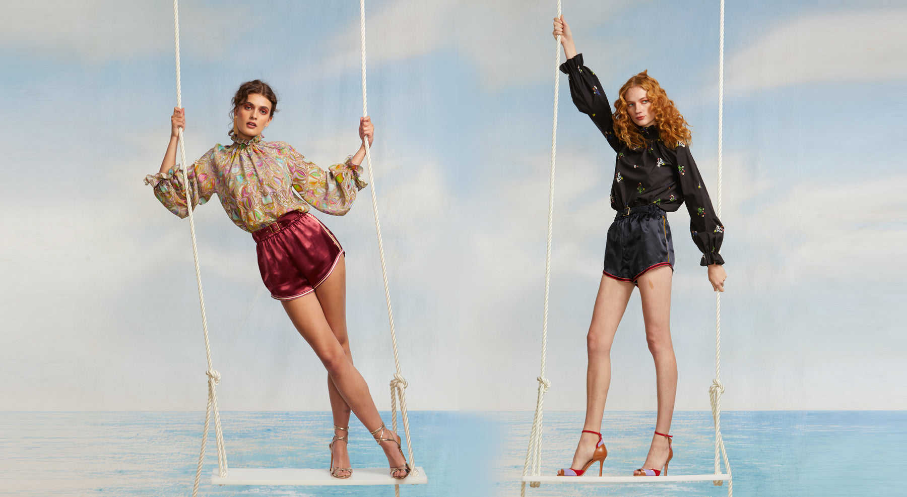 Models on swings featuring the Hudson belted boxing shorts in port and navy.