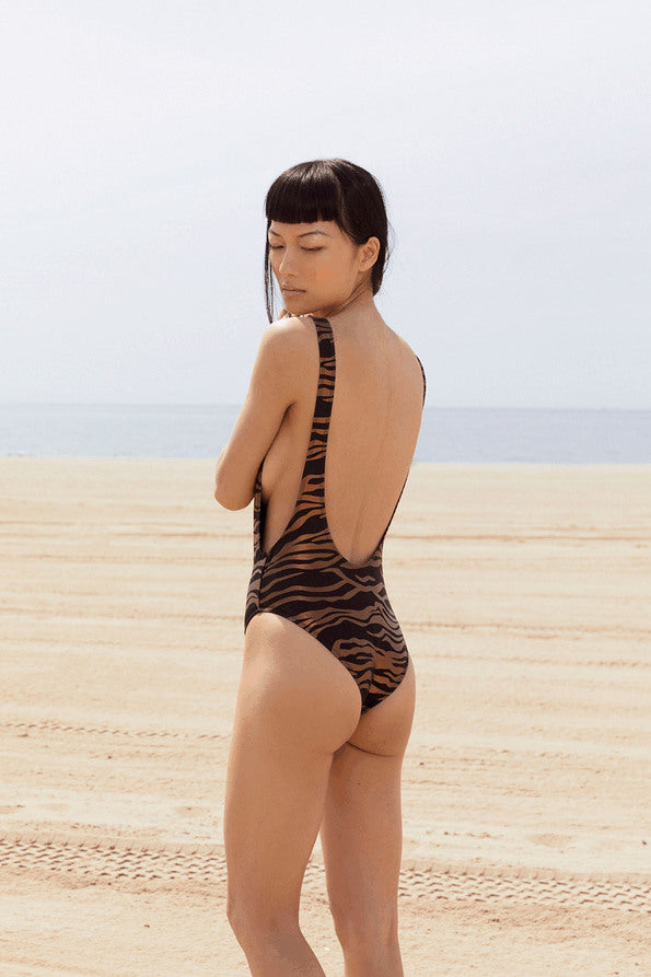 Resort Surf & Swim 2019 Collection look 1 features a swimsuit with a low back in animal print