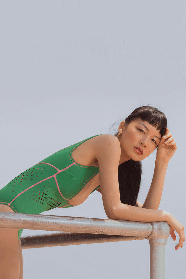 Resort Surf & Swim 2019 Collection look 11 features a swimsuit in kelly green with perforated motif across high waist and a low scoop neckline