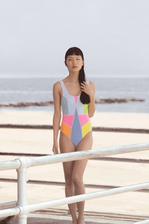 Resort Surf & Swim 2019 Collection look 12 features a swimsuit in a neon color block print