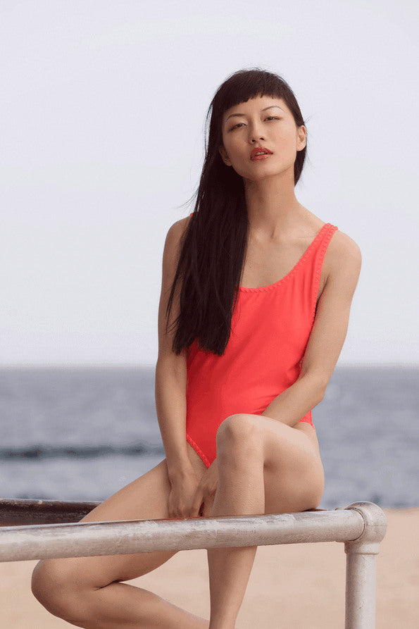 Resort Surf & Swim 2019 Collection look 15 features a red swimsuit with embroidered details and a low back