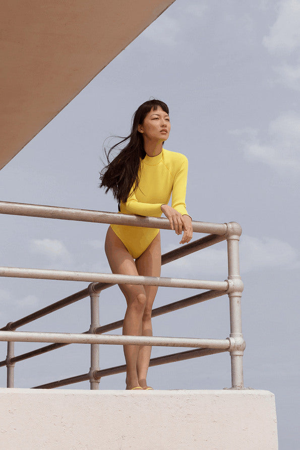 Resort Surf & Swim 2019 Collection look 17 features a yellow surfsuit with long sleeves and a high neck