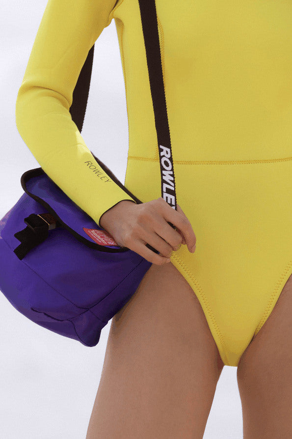 Resort Surf & Swim 2019 Collection look 18 features a yellow surfsuit with long sleeves and a high neck and