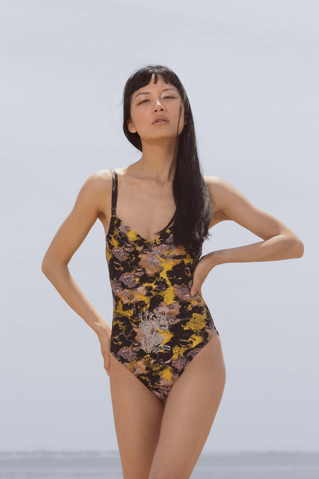 Resort Surf & Swim 2019 Collection look 2 features a swimsuit in a neon color block print