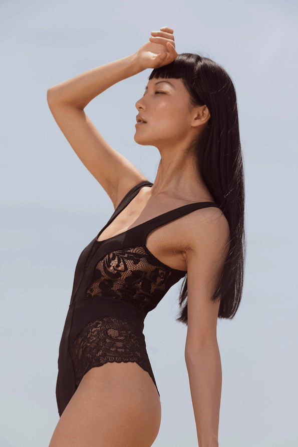 Resort Surf & Swim 2019 Collection look 5 features a swimsuit with lace panels and a low back