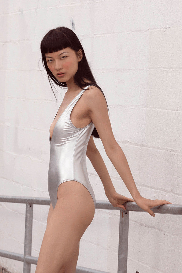 Resort Surf & Swim 2019 Collection look 8 features a swimsuit with deep v-neck in silver
