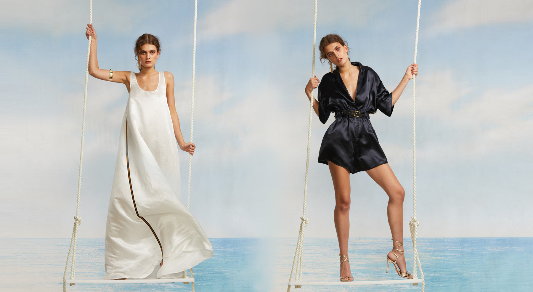 Models on swings featuring the white Tulum maxi dress and the navy Hudson belted romper.