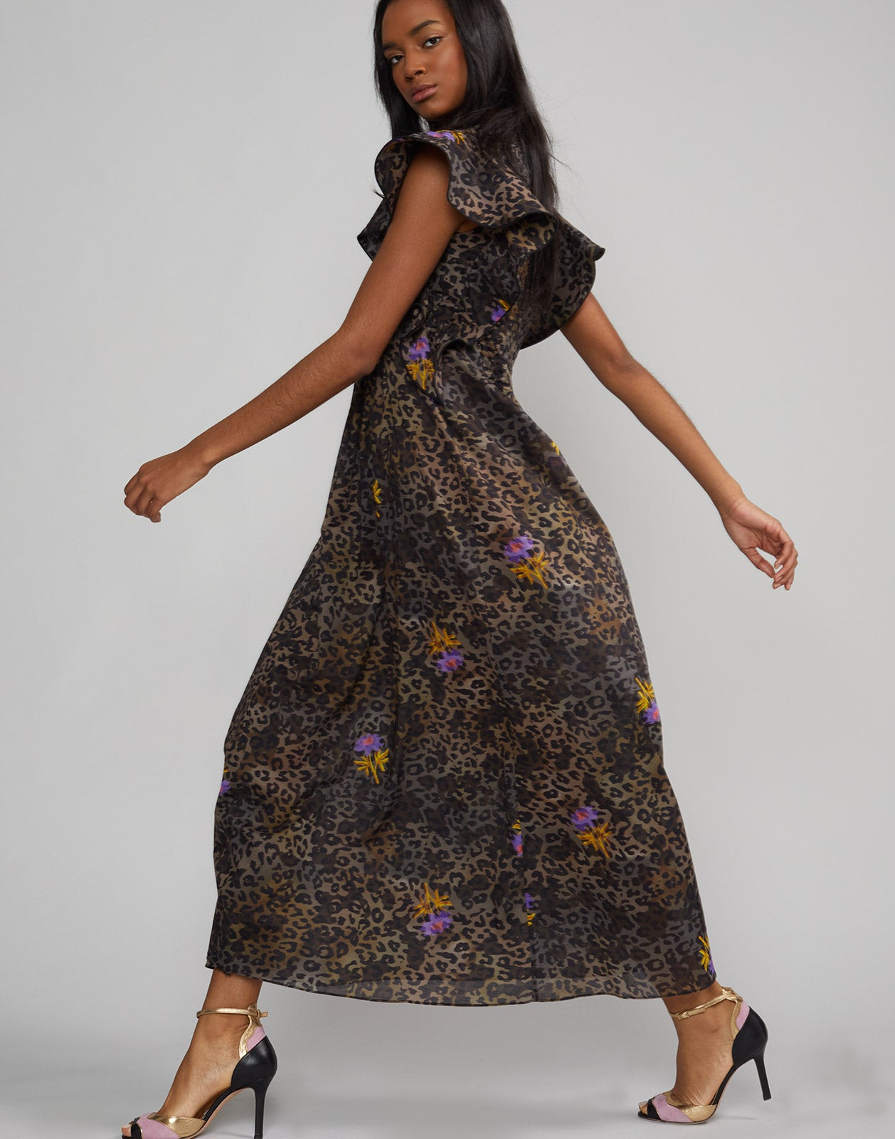 Side full view of model walking wearing Nairobi Leopard Flower Kaftan.