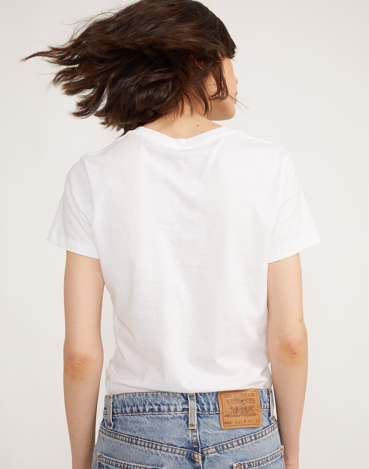 Back view of model wearing I Love You tee.