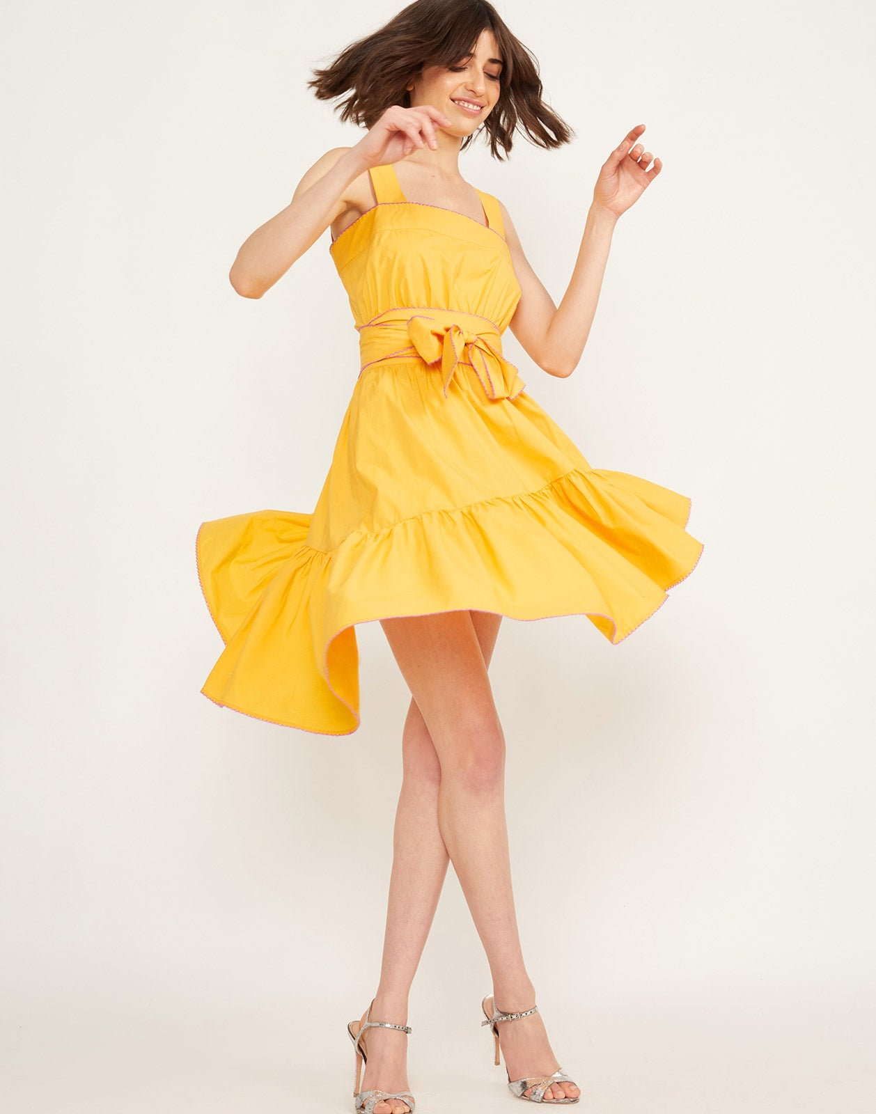 Twirling view of the Dahlia Sundress
