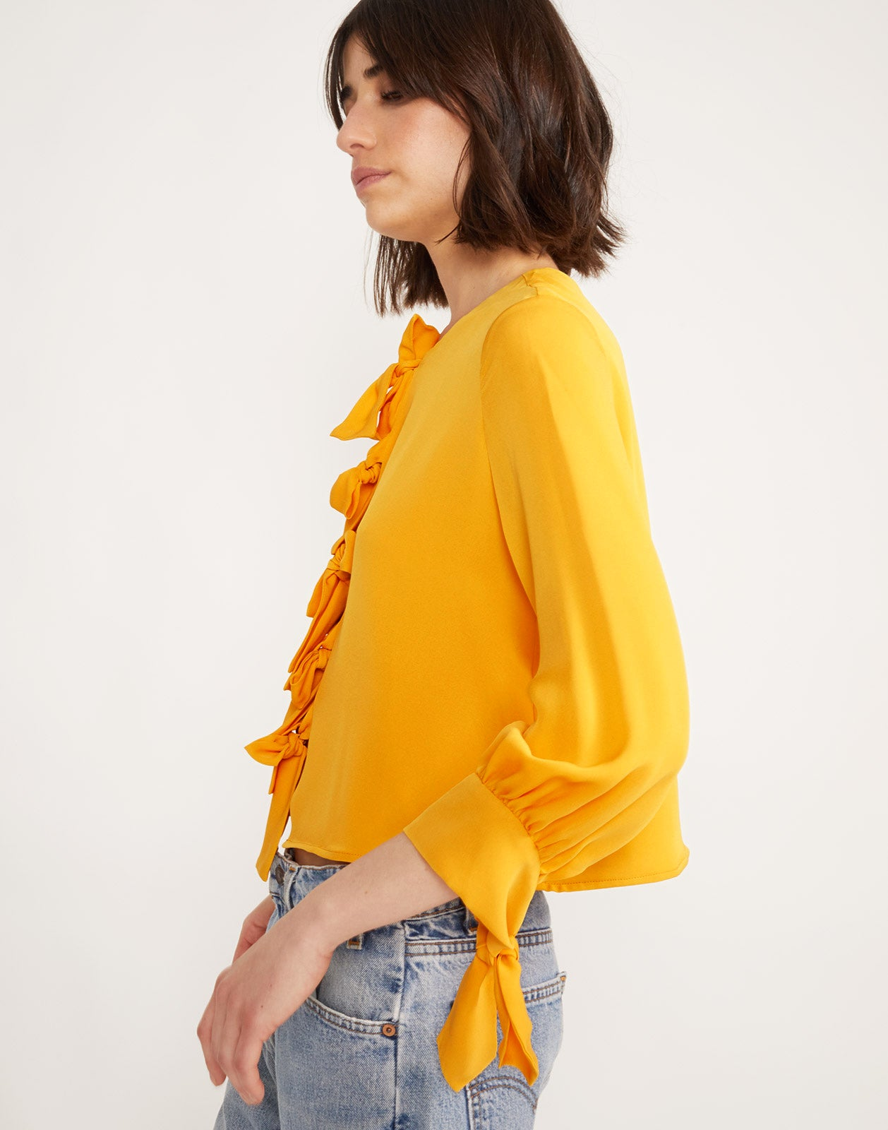 Side view of Tennessee Tie Front Top in Marigold