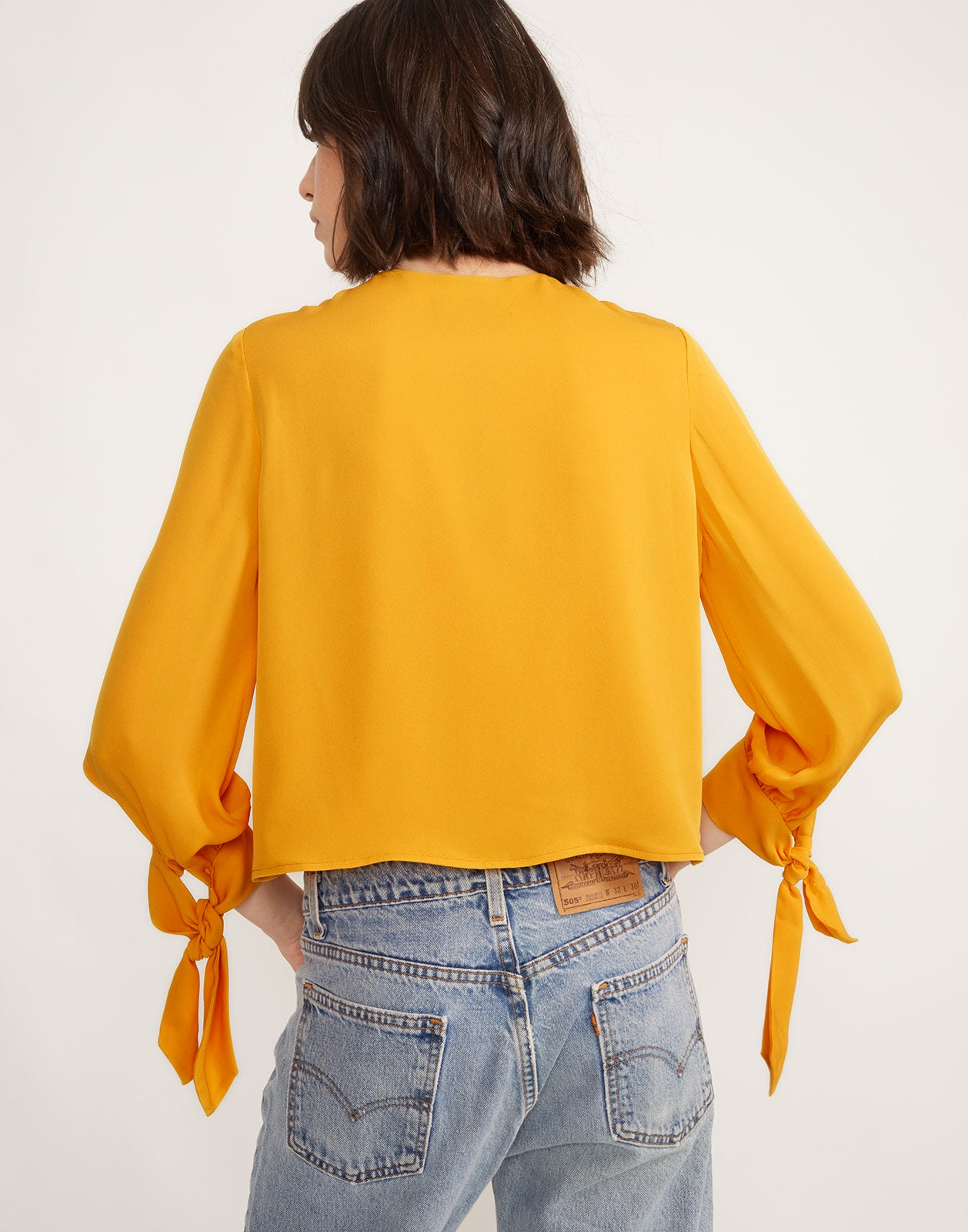 Back view of Tennessee Tie Front Top in Marigold