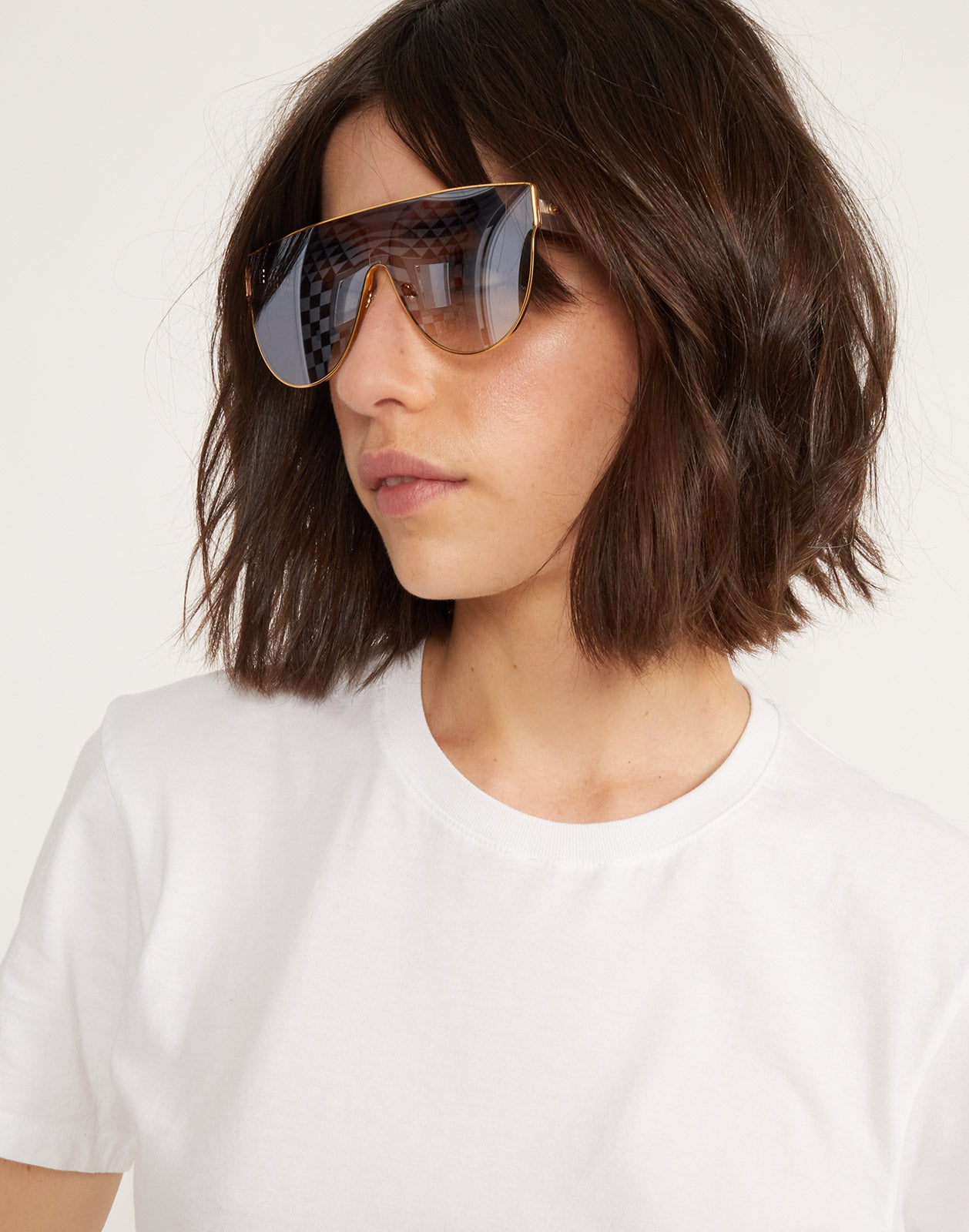 Side view of model wearing Riviera sunglasses in blush.