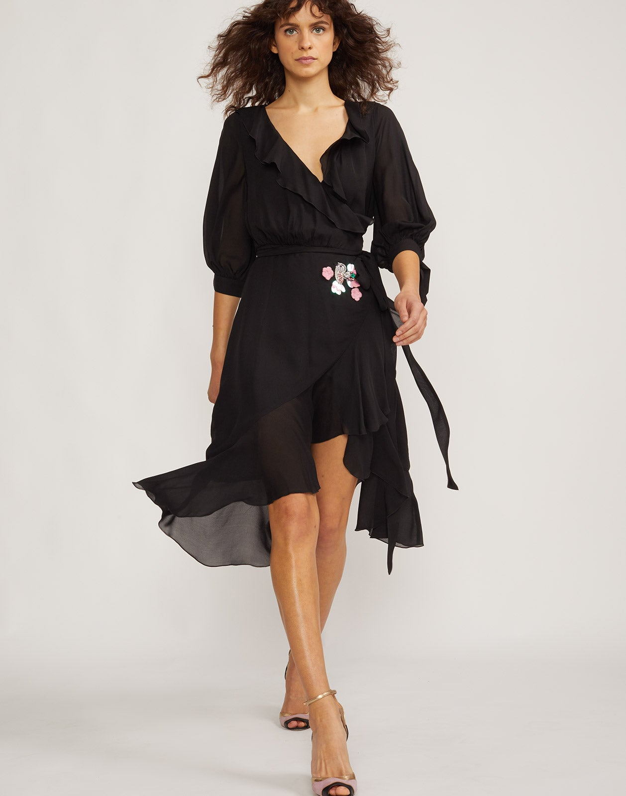 Front view of model wearing Genevieve ruffle wrap dress.