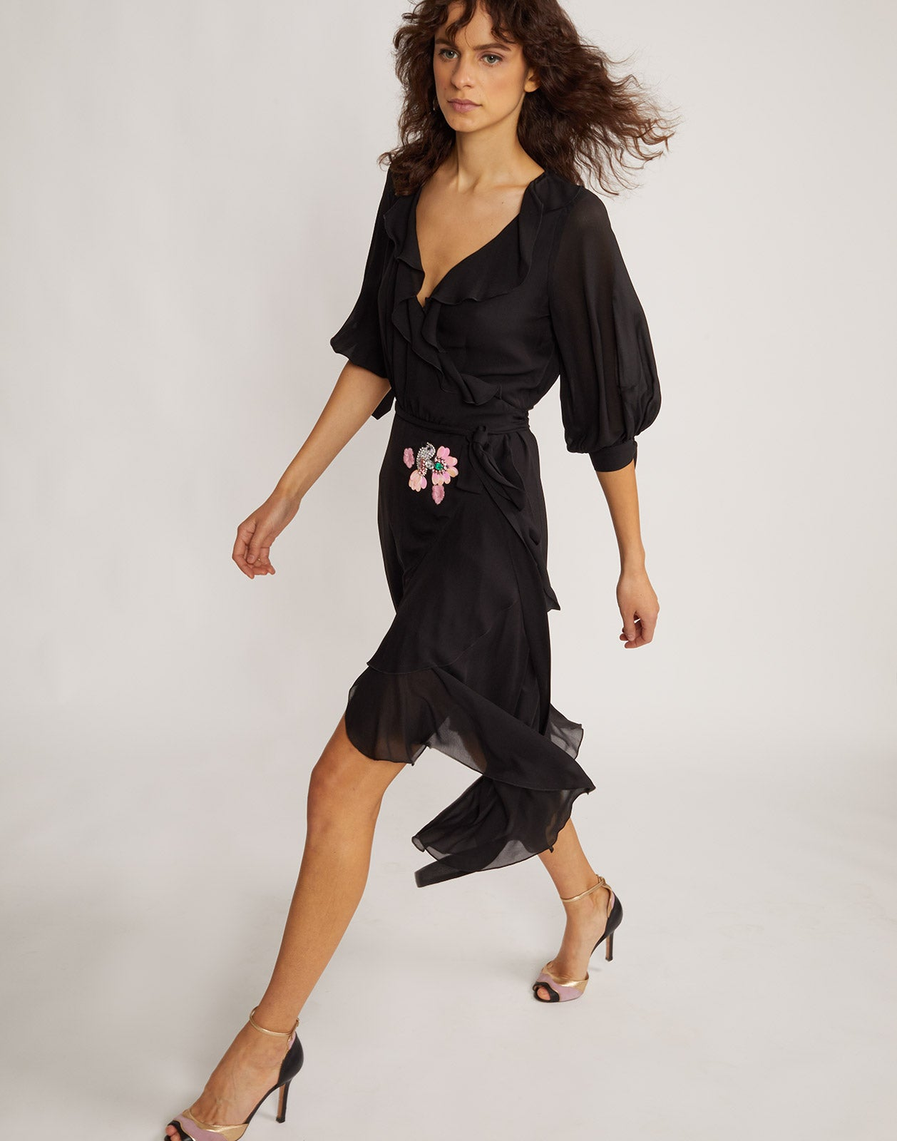 Side walking view of Genevieve ruffle wrap dress.
