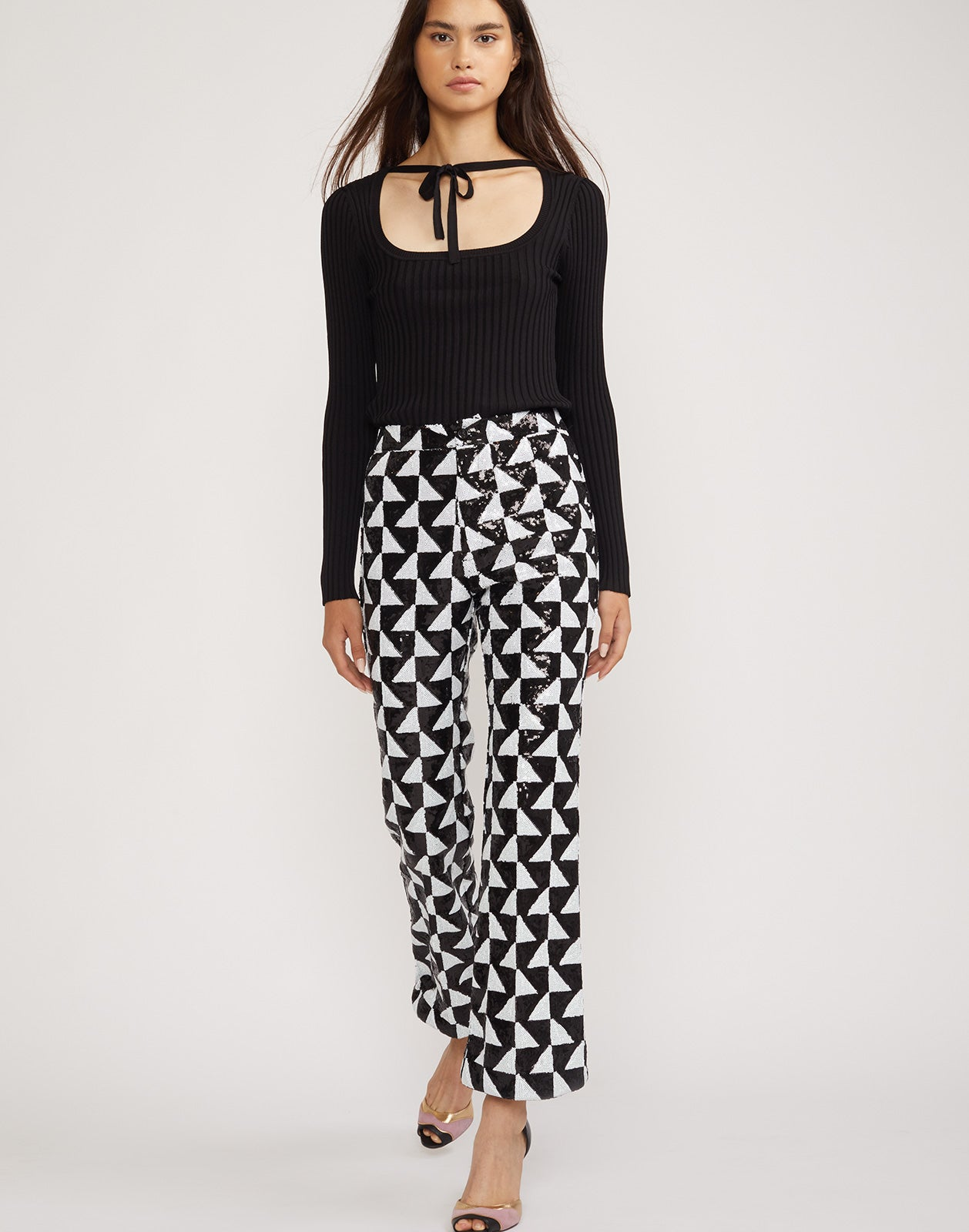 Full front view of the Illusion Geometric Sequin black and white pants.