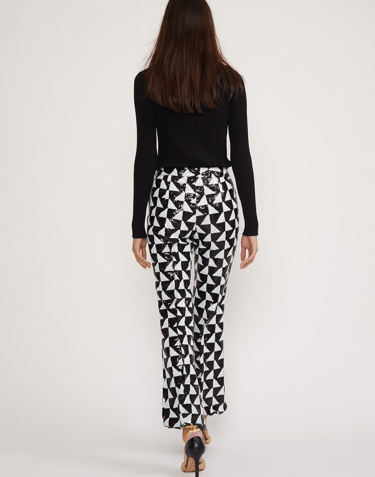 Back view of the Illusion flare pants in black and white sequins.