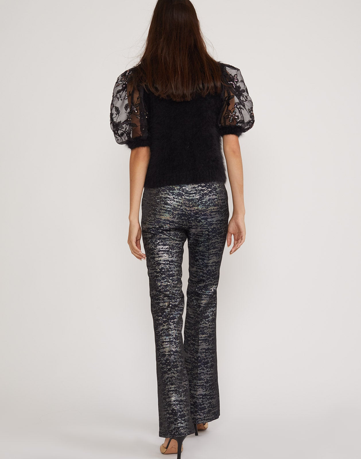 Back view of the Stella metallic brocade flare pant.