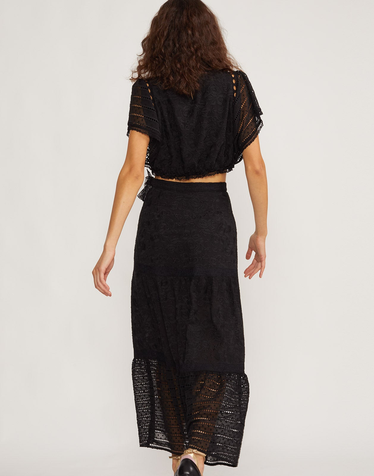 Back view of model wearing Wicker Park Lace Eyelet skirt and top.