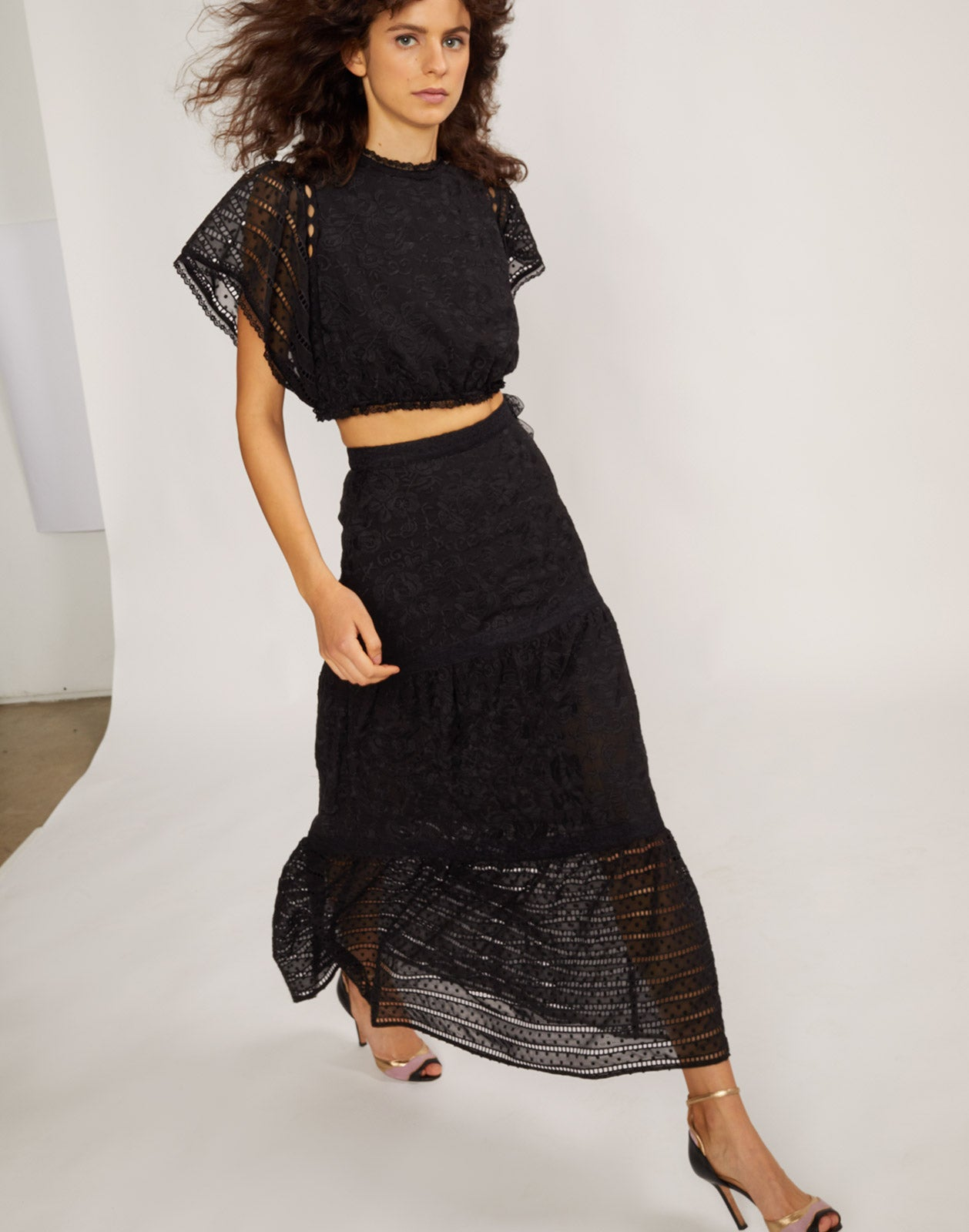 Side view of model wearing Wicker Park Lace Eyelet skirt and top.