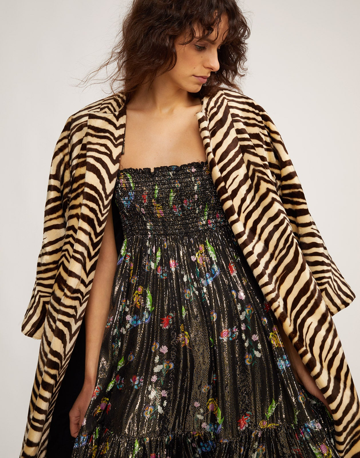 Close view of the Zebra print coat and the Parker metallic floral dress.