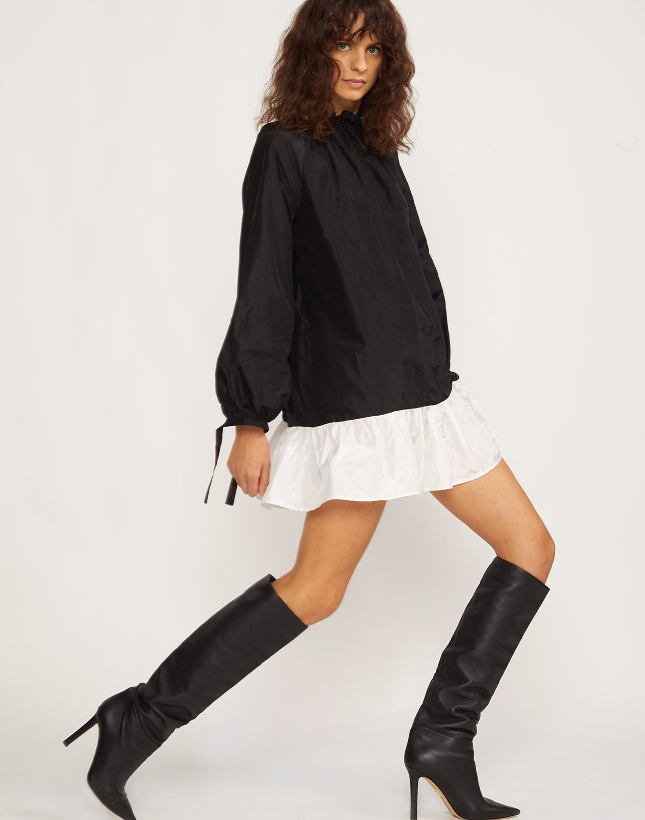 Side view of the Gisele black and white taffeta bell sleeve dress.